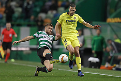 February 14, 2019 - Lisbon, Portugal - Stefan Ristovski of Sporting CP (L) vies for the ball with Alfonso Pedraza of Villarreal FC (R) during the Europa League 2018/2019 footballl match between Sporting CP vs Villarreal FC. (Credit Image: © David Martins/SOPA Images via ZUMA Wire)