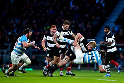 Pieter-Steph du Toit of Barbarians tackles Sebastian Cancelliere of Argentina - Mandatory by-line: Robbie Stephenson/JMP - 01/12/2018 - RUGBY - Twickenham Stadium - London, England - Barbarians v Argentina - Killick Cup