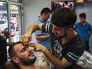Mehmet has been working in barber shops since he was 7 years old.