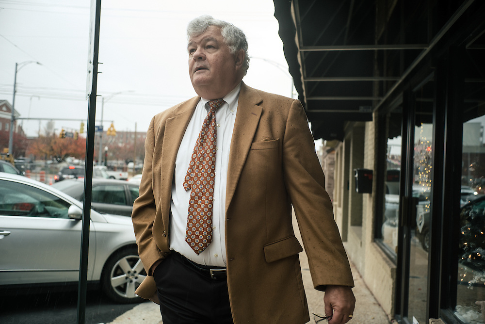 AUBURN, AL – NOVEMBER 20, 2016: Philip Dunlap, the city of Auburn's Economic Development Director, walks through downtown Auburn. After working for the city of Birmingham for nearly a decade, Dunlap was recruited by the city of Auburn in 1984 to start the city's Economic Development Program. Since that time, the city has witnessed significant growth and development.<br /> <br /> In much of the United States, global trade and technological innovation has failed to produce the prosperity hoped for by political and business leaders. Yet despite formidable economic challenges, some localities are flourishing. In Lee County, Ala., unemployment is below the national average despite the loss of thousands of manufacturing jobs, and the key to the county's resilience may be Auburn University, which provided a steady source of employment during recessions and helped draw new businesses to replace those that fled. CREDIT: Bob Miller for The Wall Street Journal<br /> [RESILIENT]