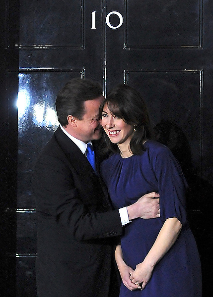 Prime Minister David Cameron and his wife Samantha on the steps of Ten Downing Street before entering the building.