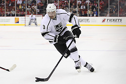 Oct 13; Newark, NJ, USA; Los Angeles Kings defenseman Drew Doughty (8) skates with the puck during the first period of their game against the New Jersey Devils at the Prudential Center.