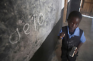 Emmanuel Makamjira, practices writing his vowels at the Alinafe Community Based Childcare Center in Mjambe Village near Zomba, Malawi. The volunteer teachers who run the centers have received training from a local CRS project through a Conrad N. Hilton Foundation grant. The project known as THRIVE focuses on early childhood development and includes special support for childcare centers, children's health and nutrition and lessons in positive parenting.