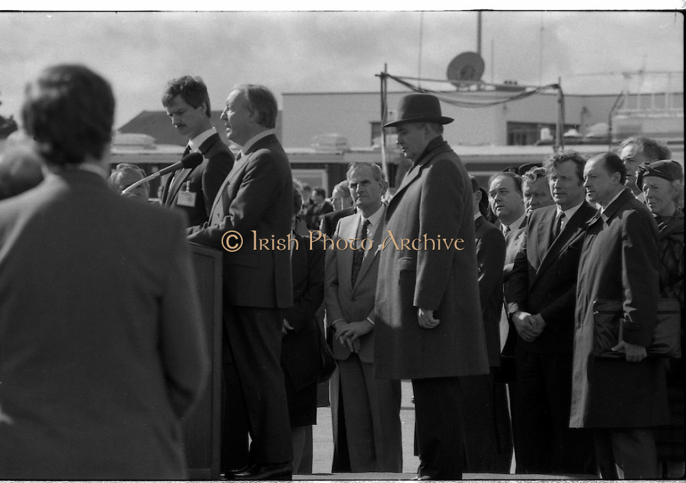 Mikhail Gorbachev Visits Ireland.  (R99)..1989..02.04.1989..04.02.1989..2nd April 1989..As part of a European tour Russian President,Mikhail Gorbachev visited Ireland today. As the architect of 'Glasnost' ,a softening of Russian opression,he was warmly welcomed on his arrival at Shannon Airport...Image shows Russian President,Mikhail Gorbachev (in hat) listening to the speech being given by An Taoiseach Charles Haughey. The Interperator is to Mr Haughey's right.