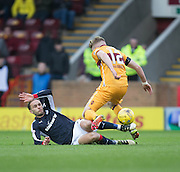 Dundee's Tom Hateley tackles Motherwell's Chris Cadden - Motherwell v Dundee in the Ladbrokes Scottish Premiership at Fir Park, Motherwell.Photo: David Young<br /> <br />  - © David Young - www.davidyoungphoto.co.uk - email: davidyoungphoto@gmail.com