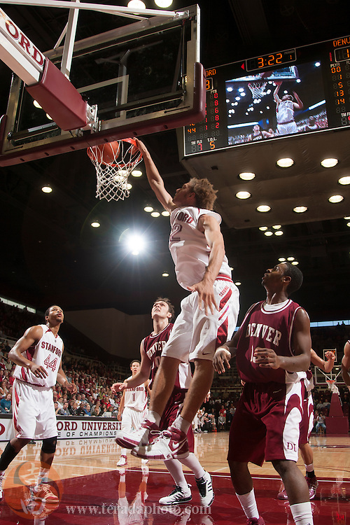 November 25, 2006; Stanford, CA, USA; Stanford Cardinal center Robin Lopez (42) dunks the basketball during the game against the Denver Pioneers at Maples Pavilion. The Cardinal defeated the Pioneers 82-39.