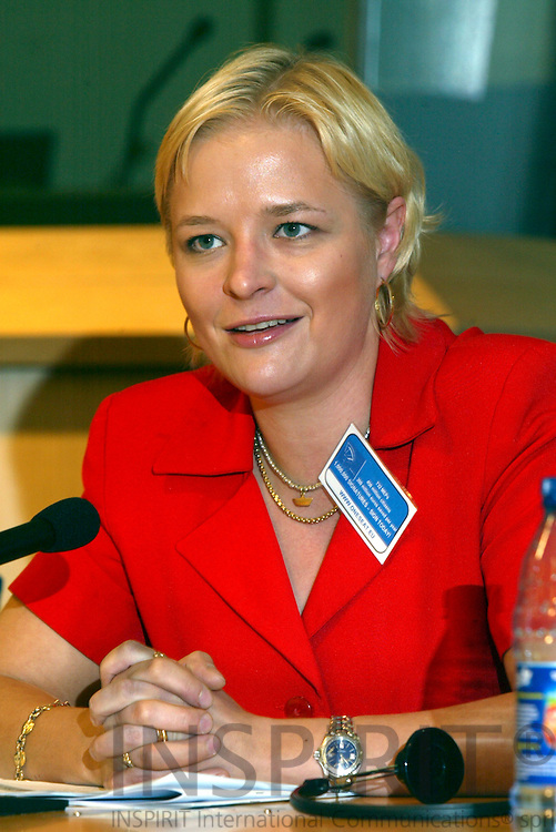 BRUSSELS - BELGIUM - 10 MAY 2006 -- Finnish MEP Piia-Noora KAUPPI, during the launch of the website www.oneseat.eu trying to close down the Parliament in Strasbourg with the help of the European Citizen. 732 MEPs have offices in Strasbourg and Brussels. Every month they and their staff move between the 2 cities and uses this kind of box for the documents and other stuff. The MEP also calls it the commuting circus. PHOTO: ERIK LUNTANG /