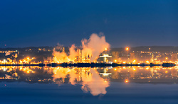 Night view of Grangemouth oil refinery operated by INEOS in Scotland, United Kingdom