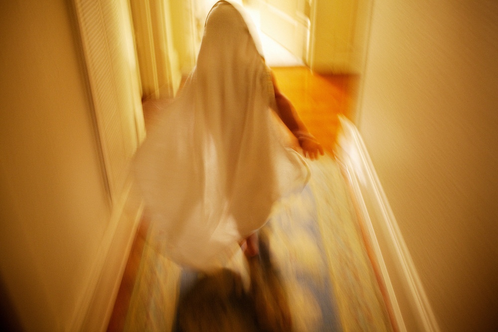 """Looking like a ghost, Madelyn Avery Eich, 2, runs down the hallway wearing only her """"duck head towel"""" after getting out of the bath in her home in Norfolk, Virginia on Wednesday, April 28, 2010."""