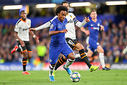 Chelsea midfielder Willan (10) is challenged by Valencia CF midfielder Daniel Parejo (10) during the Champions League match between Chelsea and Valencia CF at Stamford Bridge, London, England on 17 September 2019.