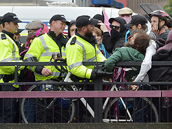 """© Licensed to London News Pictures.  10/09/2017; Bristol, UK. A police officer holds the arm of a man at a Counter demonstrators' protest against a group called British and Immigrants United Against Terrorism who joined forces with another group called Gays Against Sharia to stage a demonstration in Bristol city centre numbering about 50 people. The counter-protest was called 'Stand Up To Racism and Bigotry'. A statement issued to oppose the march says that the demonstrators """"claim falsely that they are representing the views of the LGBT+ community in Bristol,"""" adding: """"In fact, none of the organisers are LGBT+ and all the proposed speakers come from outside Bristol."""" A heavy police presence Police with riot vans dogs and horses were in attendance. Police banned face coverings, masks, banners and flags 'that might incite hatred' ahead of today's protests. Picture credit : Simon Chapman/LNP"""