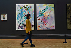 &copy; Licensed to London News Pictures. 08/06/2017. London, UK. A visitor walks in front of (L to R) &quot;She Pricked Her Fingers Cutting The Clouds&quot; and &quot;Many-Coloured Messenger Seeks Her Fortune&quot; both by Fiona Rae RA. Preview of the Summer Exhibition 2017 at the Royal Academy of Arts in Piccadilly.  Co-ordinated by Royal Academician Eileen Cooper, the 249th Summer Exhibition is the world's largest open submission exhibition with around 1,100 works on display by high profile and up and coming artists.<br />  Photo credit : Stephen Chung/LNP