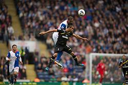BLACKBURN, ENGLAND - Sunday, October 23, 2011: Tottenham Hotspur's Benoit Assou-Ekotto in action against Blackburn Rovers' Steven Nzonzi during the Premiership match at Ewood Park. (Pic by David Rawcliffe/Propaganda)