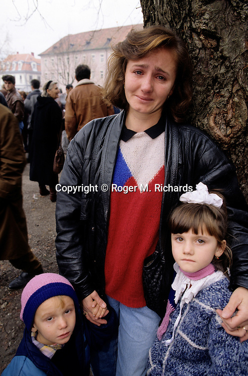 A Bosnian refugee family in shock after realizing that her husband and the children's father is not among the newly released Bosniak prisoners from the notorious Bosnian Serb concentration camp called Manjaca, in Karlovac, Croatia, October 1992.