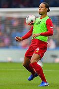 Liverpool defender Virgil van Dijk (4) warms up prior to the Premier League match between Chelsea and Liverpool at Stamford Bridge, London, England on 22 September 2019.