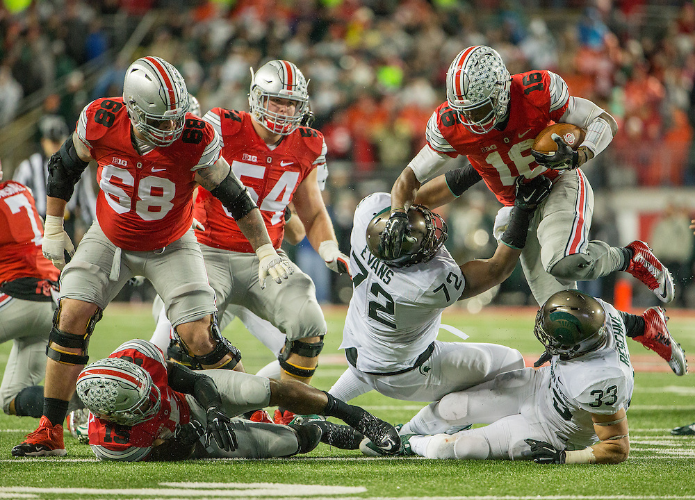 Michigan State University defensive tackle Craig Evans (72) tackles Ohio State University quarterback J.T. Barrett (16) during the second half of a NCAA Division I football game between Ohio State University and the Michigan State University at Ohio Stadium on November 21, 2015 in Columbus, Ohio. (Dustin Satloff)