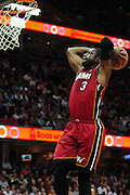 March 29, 2010; Cleveland, OH, USA; Miami Heat shooting guard Dwyane Wade (3) flies in for a dunk during the third quarter against the Cleveland Cavaliers at Quicken Loans Arena. The Cavaliers beat the Heat 102-90. Mandatory Credit: Jason Miller-US PRESSWIRE