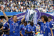 Chelsea Defender John Terry (26) and Chelsea Defender David Luiz (30) celebrates with the trophy during the Premier League match between Chelsea and Sunderland at Stamford Bridge, London, England on 21 May 2017. Photo by Andy Walter.