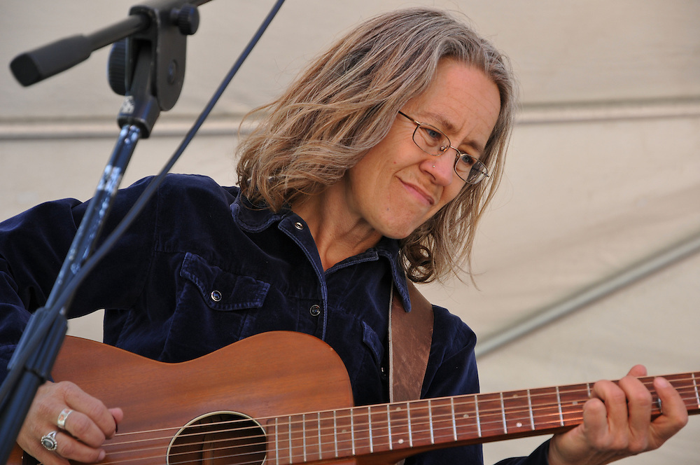 Mitzi Cowell plays guitar during the Jaese Lecuyer concert at the 2011 Tucson Folk Festival. Event photography by Martha Retallick.