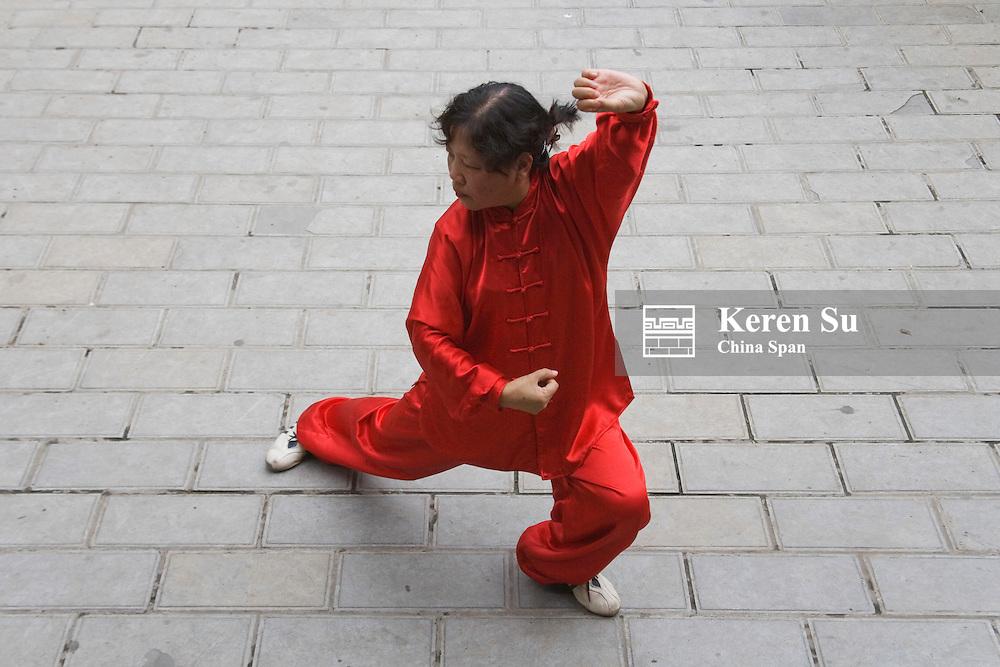 Woman playing Taichi, Guiyang, Guizhou, China