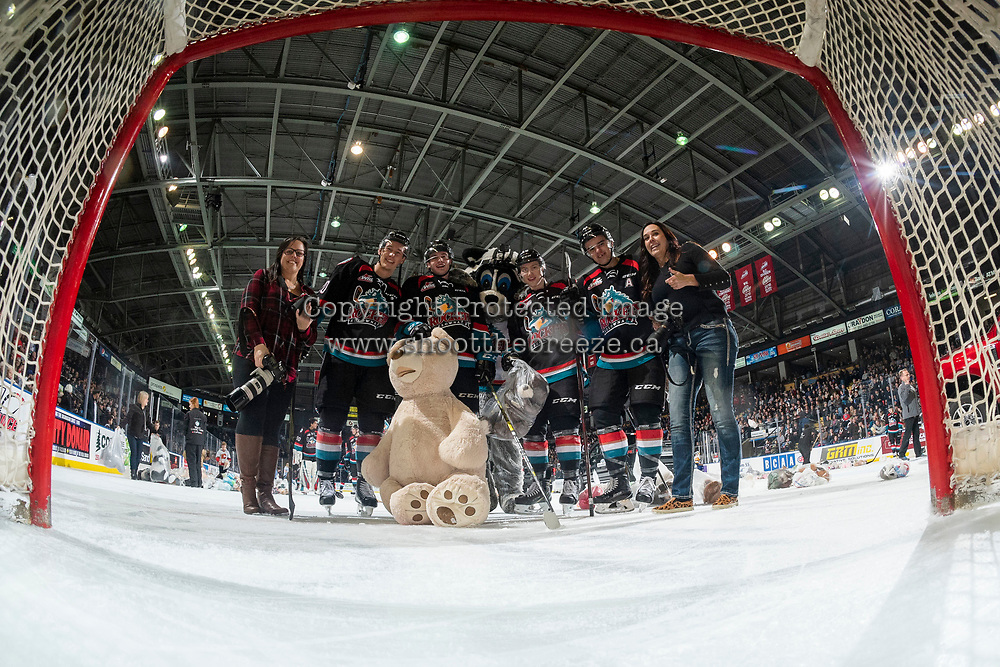 KELOWNA, CANADA - DECEMBER 1: Kelowna Rockets' team photographers Cindy Rogers and Marissa Baecker, pose with mascot Rocky Raccoon and Conner Bruggen-Cate #20, Mark Liwiski #9, Michael Farren #16 and Erik Gardiner #11 of the Kelowna Rockets for a net cam selfie during the annual Teddy Bear Toss against the Saskatoon Blades  on December 1, 2018 at Prospera Place in Kelowna, British Columbia, Canada.  (Photo by Marissa Baecker/Shoot the Breeze)