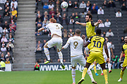 John-Joe O'Toole (21) beats Dean Lewington (3) to the ball during the EFL Sky Bet League 1 match between Milton Keynes Dons and Burton Albion at stadium:mk, Milton Keynes, England on 5 October 2019.