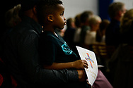A young boy listens as the Rev. Dr. Matthew C. Harrison, president of the LCMS, preaches during the 500th Anniversary of the Reformation festival worship service on Sunday, Oct. 29, 2017, in the Gangelhoff Center at Concordia University, St. Paul, in St. Paul, Minn. The service was held in conjunction with Concordia University, St. Paul, and the Minnesota North and South Districts of the Lutheran Church-Missouri Synod. LCMS Communications/Erik M. Lunsford