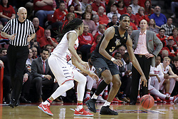 20 March 2017:  Tony Wills(12) defends A.J. Davis during a College NIT (National Invitational Tournament) 2nd round mens basketball game between the UCF (University of Central Florida) Knights and Illinois State Redbirds in  Redbird Arena, Normal IL