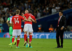 TOULOUSE, FRANCE - Monday, June 20, 2016: Wales' manager Chris Coleman and David Edwards celebrate at the final whistle after beating Russia 3-0 and qualifying for the knock-out stage during the final Group B UEFA Euro 2016 Championship match at Stadium de Toulouse. (Pic by David Rawcliffe/Propaganda)