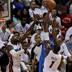 Jun 21, 2012; Miami, FL, USA; Oklahoma City Thunder small forward Kevin Durant (35) shoots over Miami Heat small forward LeBron James (6) and power forward Chris Bosh (1) during the first quarter in game five in the 2012 NBA Finals at the American Airlines Arena. Mandatory Credit: Derick E. Hingle-US PRESSWIRE