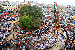 May 7, 2017 - Lalitpur, Nepal - People participate in the chariot procession of Rato Machhendranath, God of rain at Lagankhel. Rato Machhendranath is known as the God of rain and both Hindus and Buddhists worship for good rain to prevent drought during the rice harvest season. (Credit Image: © Archana Shrestha/Pacific Press via ZUMA Wire)