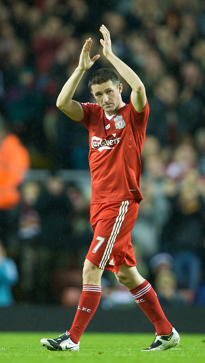 LIVERPOOL, ENGLAND - Saturday, November 8, 2008: Liverpool's two goal hero Robbie Keane salutes the supporters on the Spion Kop, as he is substituted against West Bromwich Albion, during the Premiership match at Anfield. (Photo by David Rawcliffe/Propaganda)