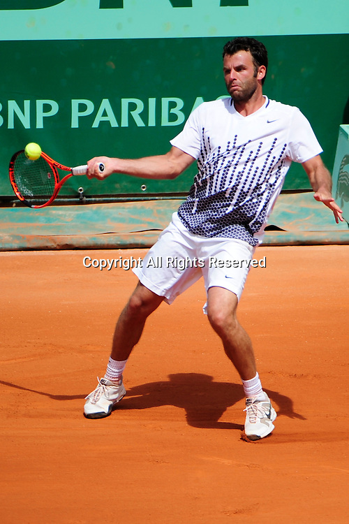 22.05.2011 French Open Tennis from Roland Garros Paris. Marc Gicquel of France returns a shot in his match against Albert Montanes of Spain. The match was won by Montanes 6-4, 6-4, 6-2.