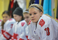 DMITROV, RUSSIA - JANUARY 9: Switzerland's Stefanie Wetli #18 looks on while sitting in the dressing room prior to preliminary round action against Germany at the 2018 IIHF Ice Hockey U18 Women's World Championship. (Photo by Steve Kingsman/HHOF-IIHF Images)