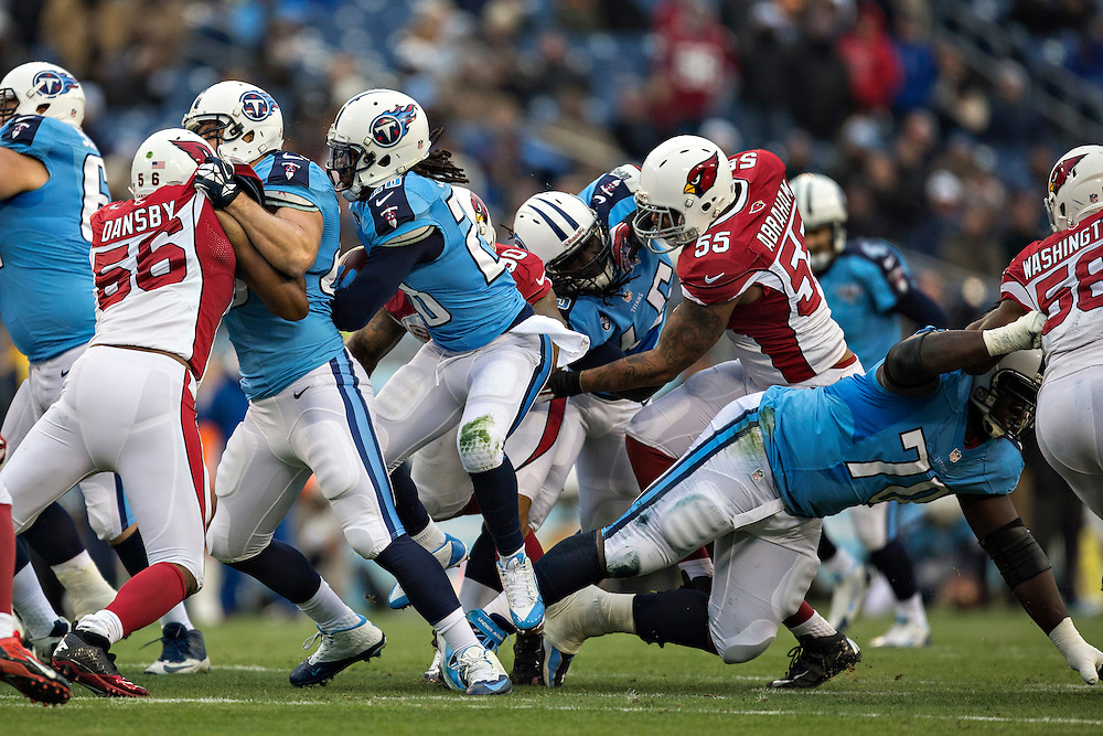 NASHVILLE, TN - DECEMBER 15: Chris Johnson #28 of the Tennessee Titans runs the ball through the line of scrimmage during a game against the Arizona Cardinals at LP Field on December 15, 2013 in Nashville, Tennessee.  The Cardinals defeated the Titans 37-34.  (Photo by Wesley Hitt/Getty Images) *** Local Caption *** Chris Johnson