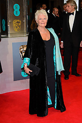 Dame Judi Dench attends the EE British Academy Film Awards in 2014. The Royal Opera house, London, United Kingdom. Sunday, 16th February 2014. Picture by Chris Joseph / i-Images