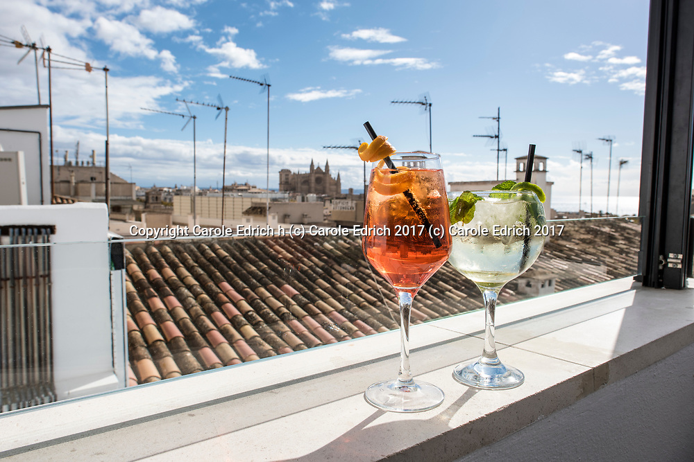 Aperol spritz  and mojito on slef overlooking view of cathedral, long roof and sky from Cuit, Nakar Hotel. (c) Carole Edrich 2017