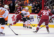 Dec. 3 2011; Glendale, AZ, USA; Philadelphia Flyers forward Jaromir Jagr   (68) handles the puck while playing against the Phoenix Coyotes during the first period at Jobing.com Arena. The Flyers defeated the Coyotes 4-2. Mandatory Credit: Jennifer Stewart-US PRESSWIRE.