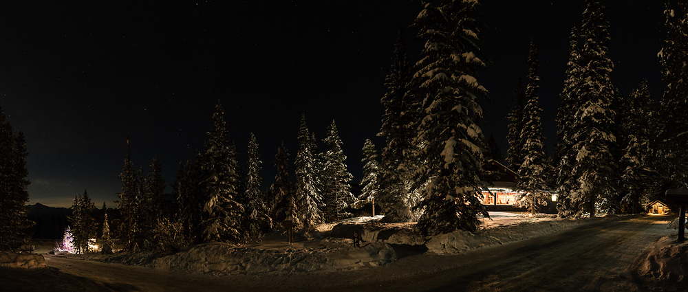 A panoramic night shot of the Storm Mountain Lodge and restaurant during the Christmas Season.