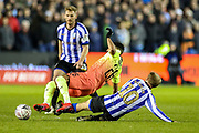 Sheffield Wednesday midfielder Barry Bannan (10) slides in to tackle Manchester City midfielder Riyad Mahrez (26) during The FA Cup match between Sheffield Wednesday and Manchester City at Hillsborough, Sheffield, England on 4 March 2020.