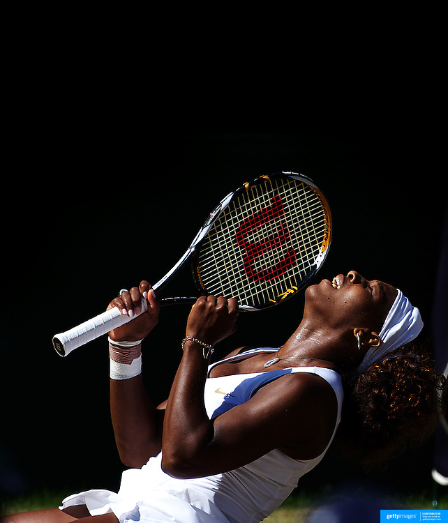 Serena Williams, USA, falls to her knees as she celebrates her victory over sister Venus Williams, USA, during the Ladies Singles Final at the All England Lawn Tennis Championships at Wimbledon, London, England on Saturday, July 04, 2009.