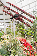 Flower planes dogfight over the City of Birmingham garden which incudes a mock up World War 1 trench. The Chelsea Flower Show 2014. The Royal Hospital, Chelsea, London, UK