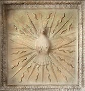Dove in flames, representing the philosophical soul, and the descent of the terrestrial fire in Christian tradition, from the coffered ceiling of the Oratory, carved in stone with 30 sections, each relating to a process in alchemy, in the Hotel Lallemant, a mansion built 1495-1518 in French Renaissance style by the Lallemant merchant family, in Bourges, Centre Val de Loire, France. The sculptural decoration on the building, made by both French and Italian sculptors, has been interpreted by Fulcanelli and others as having an alchemical symbolism. Since 1951 the building has housed the Musee des Arts Decoratifs and it was listed as a historic monument in 1840. Picture by Manuel Cohen