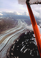 Turning over The Great Gorge leading to Ruth's Glacier on the outbound leg on the return after &quot;Flightseeing Mt. McKinley back to Talkeetna Airport 50 miles to the south of the mountain. <br /> <br /> Taken from right seat of a DeHaveland Beaver Aircraft, the Bush Pilot's Work Horse.