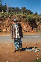 An elderly gentleman poses near Ooty, India