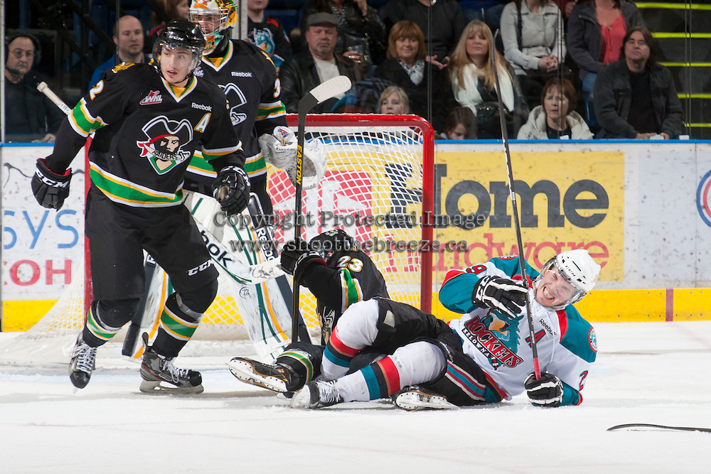 KELOWNA, CANADA - JANUARY 26: Myles Bell #29 of the Kelowna Rockets falls to the ice against the Prince Albert Raiders at the Kelowna Rockets on January 26, 2013 at Prospera Place in Kelowna, British Columbia, Canada (Photo by Marissa Baecker/Shoot the Breeze) *** Local Caption ***