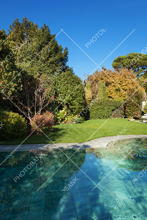 Exterior of a villa, beautiful garden with pool