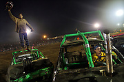 Arkansas Democrat-Gazette/BENJAMIN KRAIN --9/14/2013--<br /> A driver ID TO COME celebrates atop his car after becoming the &quot;Last Man Standing&quot; and thereby winning the mini car division of the White County Fair Demolition Derby