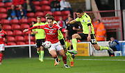 Walsall striker, Tom Bradshaw breaks forward during the Capital One Cup match between Walsall and Brighton and Hove Albion at the Banks's Stadium, Walsall, England on 25 August 2015.