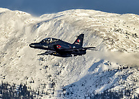 A Royal Canadian Air Force British Aerospace CT-155 Hawk advanced jet training aircraft passes in front of Grey Mountain in Whitehorse, Yukon, during Yukon Sourdough Rendezvous 2018